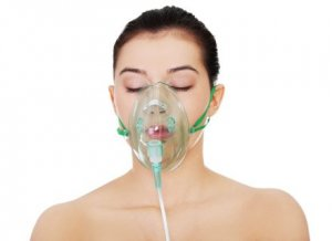 Diseased female with an oxygen mask